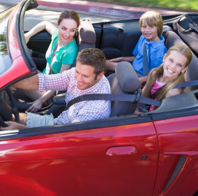 Family dirivng in their car. Wilmington auto insurance information.